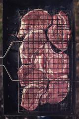 Grilling fresh entrecote pork