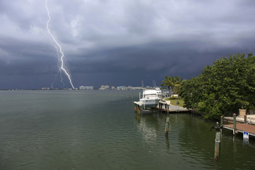 A tropical storm with lightning blows in over Sarasota Bay FL