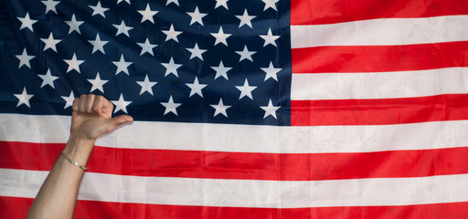 thumbs up on the background of the American flag