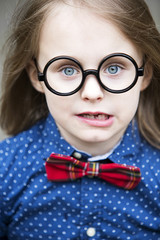 blond boy with bow tie and big glasses