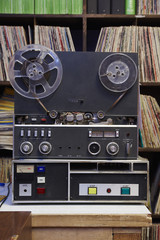 Collection of vinyl LP records and tape recorder