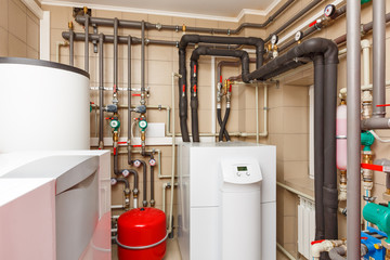 Household boiler house with heat pump, barrel; Valves; Sensors and an automatic control unit