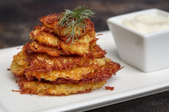 Tasty potato pancakes or latke with sauce
