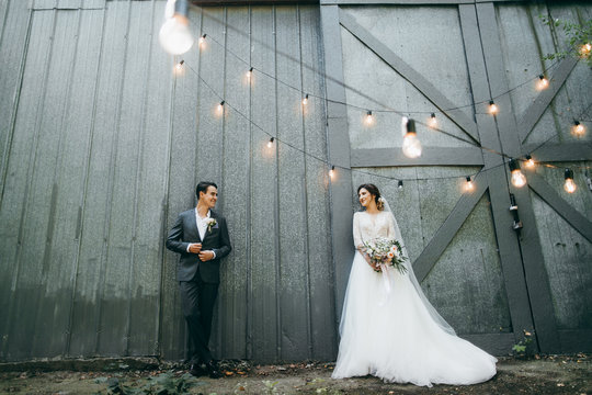 Young marriage couple in rustic style at summer