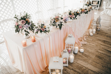 Pink wedding decoration with white and green flowers