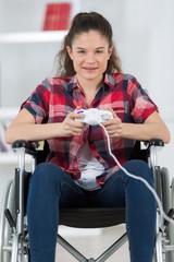 young girl in wheelchair playing video games