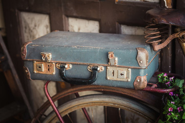 Old vintage suitcase and bicycle