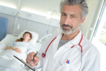 doctor posing in the patient's room