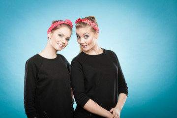 Two funny positive retro styled female portrait.