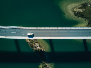 Aerial photograph of a bridge at lake Sylvenstein with car