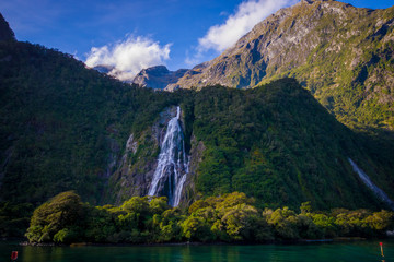 Landscape of high mountain glacier at milford sound with a beautiful lake and waterfall, in south island in New Zealand