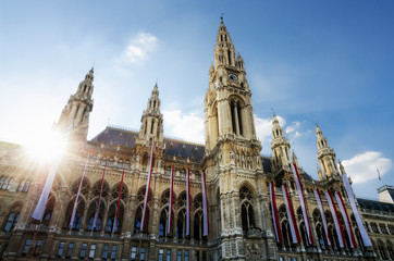 Foto op Canvas Wenen The Wiener Rathaus (Vienna City Hall, Austria) at sunset, with austrian flags over the facade