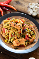 Traditional indonesian meal bami goreng with noodles, vegetables and chicken