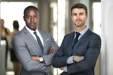 Business partners, possibly attorneys or lawyers standing at the office business workplace