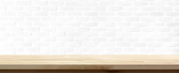 Wood table top on white brick wall background