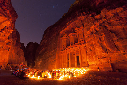 Petra by Night and sky full of stars