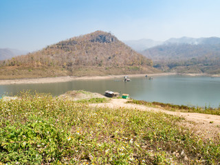 Houseboat and  fishing boat in Thailand lake,summer season