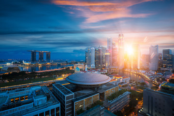 Wall Mural - Singapore city with sunrise by day to night photo