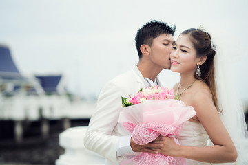 Asian couple just marriage kiss in bridge