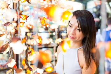 Asian Woman shopping in market