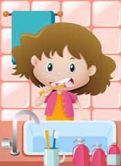 Girl brushing teeth at the sink
