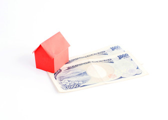 Red House paper and Japan money banknote for loans concept