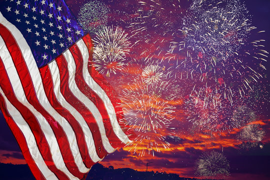 United States Flag, lots of fire works against the darkened sky.