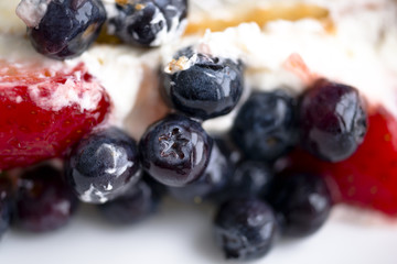 Fruit cake with strawberries and blueberries