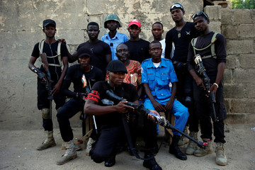 A unit of the local militia group, otherwise kown as CJTF, pose for a group photograph in a compound in Maiduguri