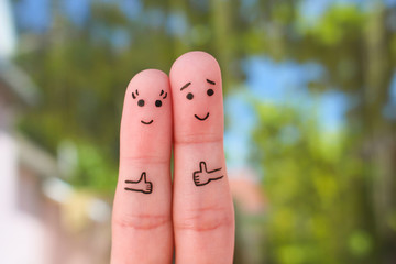 Fingers art of Happy couple showing thumbs up.