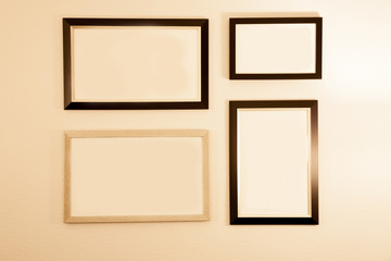 empty photo frames on the white wall.