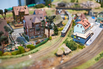Toy railway with train and houses