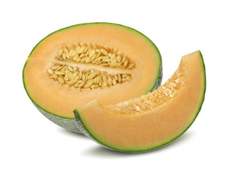 Cantaloupe melon half and pieces isolated on white