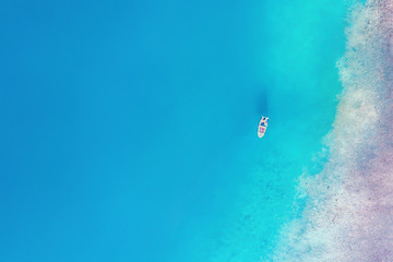 Top view of a white yacht in the sea