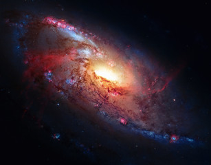 M106, Spiral Galaxy in the constellation Canes Venatici. Elements of this image furnished by NASA.