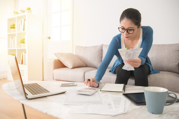 housewife calculating accounting budget