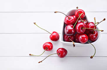Cherries on white wood background