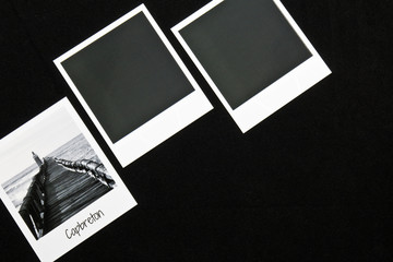 retro vintage three instant photo frames cards on black background with a photo of capbreton breakwater in black and white with copy space text