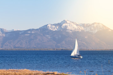 Sailing boat on lake chiemsee near Seebruck with lense flares