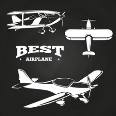 White airplanes collection on chalkboard design