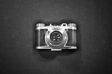 top view nostalgic art concept of old retro vintage camera isolated and highlighted in black and white