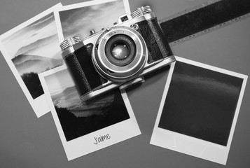 Retro vintage four instant photo frames cards on grey background with images of nature with text j`aime and blank black photo frame with old camera and film strip top view in black and white