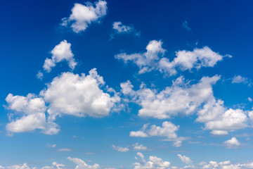 Sunny day with fluffy clouds in the blue sky