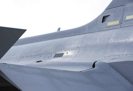 Metal surface of a modern tactical fighter. Round shape and design of the jet fighter.