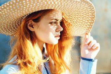 Woman in a hat looks away, profile, portrait
