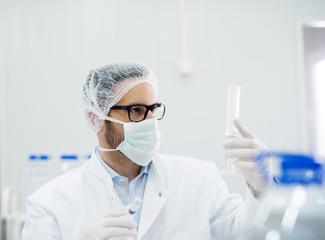 Lab technician doing chemical analysis. Testing chemical composi