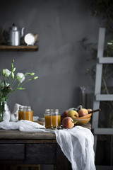 Homemade Peach jam and fresh peaches on a table