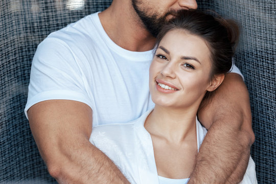Portrait of young loving couple hugging