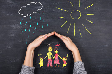 hands protects family from the elements - rain or storm
