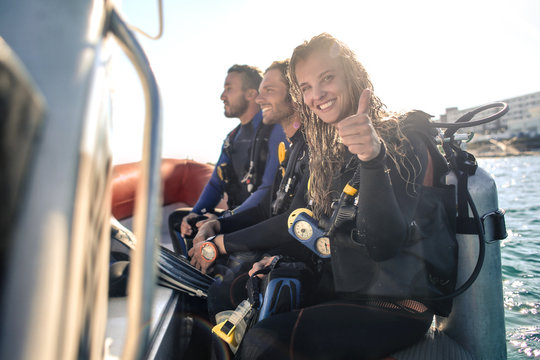 Group of scuba divers on a boat